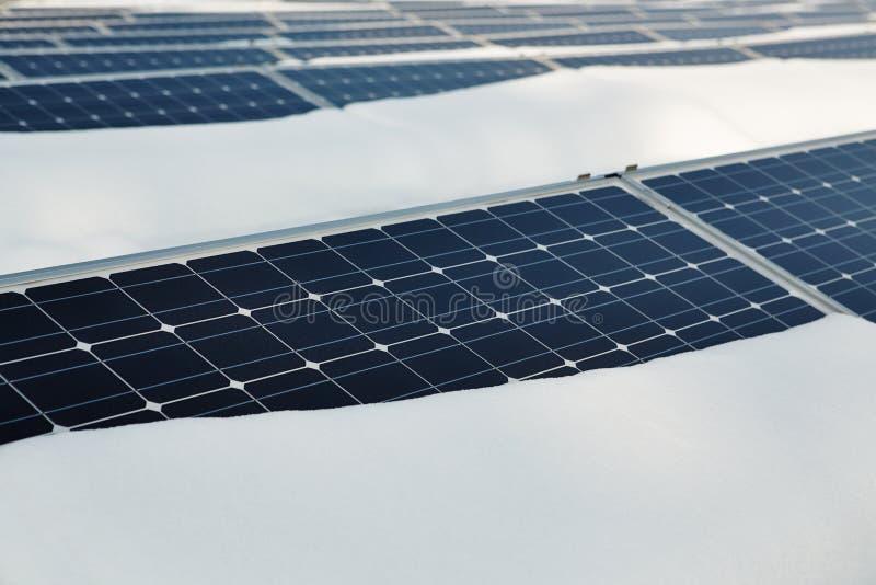 Snow-covered solar panel stock photo