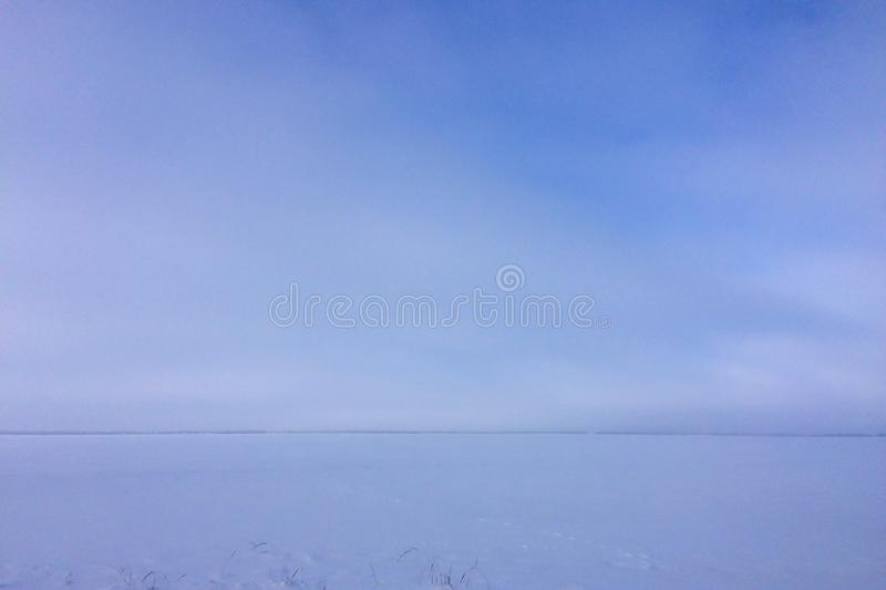 Horizon line. Snow-covered steppe, Russian winter, frosty weather, horizon line royalty free stock image