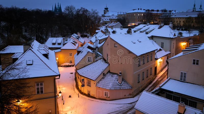 Snow covered street and roofs in old town of Prague, Czech Republic royalty free stock photography