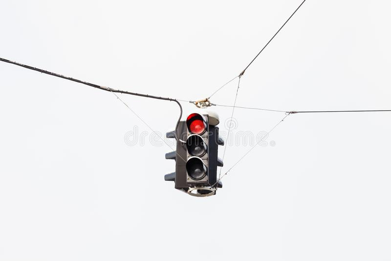 A Snow Covered Suspended Red Traffic Light royalty free stock photography