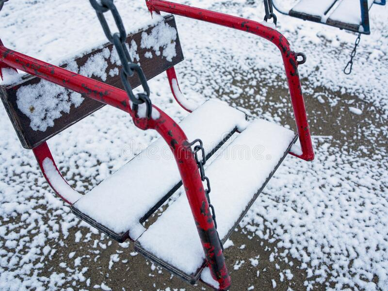 Snow-Covered swing royalty free stock photos