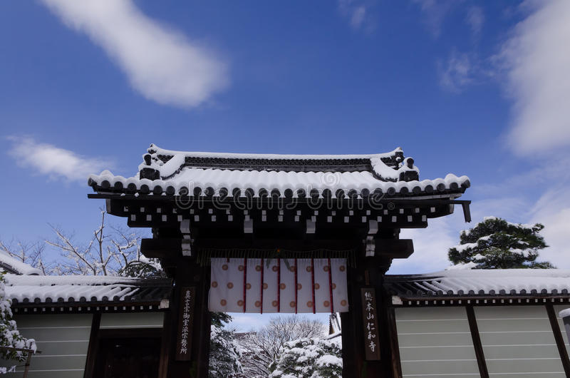 Snow covered temple, winter in Kyoto Japan. Picture of snow covered the gate of Ninnaji temple and blue sky in winter, Kyoto Japan stock photography
