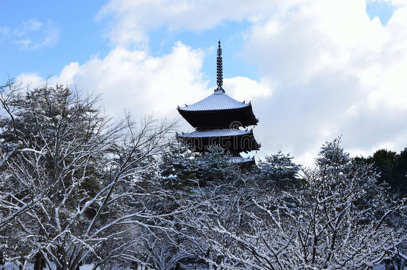 Snow covered temple, winter in Kyoto Japan. Picture of snow covered pagoda of Ninnaji temple and trees in winter, Kyoto Japan royalty free stock photos
