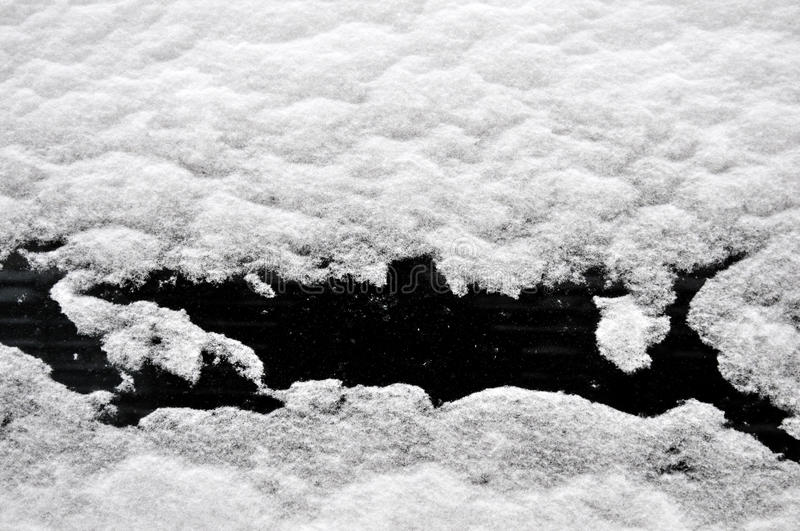 Window covered with snow stock photos