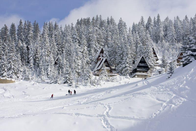 Snow covered winter ski center stock images