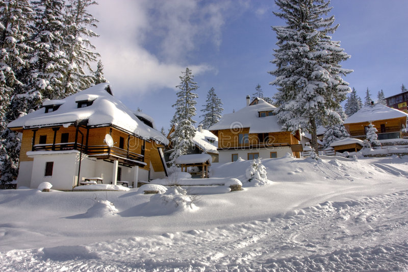 Snow covered winter ski center stock photography