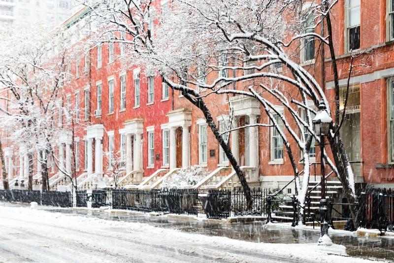 Snow covered winter street scene in New York City. Snow covered winter street scene with view of the historic buildings along Washington Square Park in New York stock photo