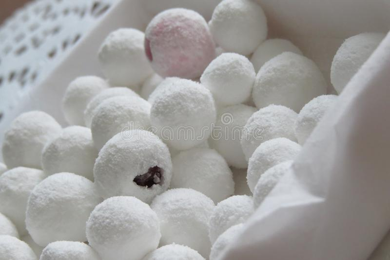 Snow cranberries in sugar. Sweet and sour dessert in a sweet snow dump. Cranberries stock photography