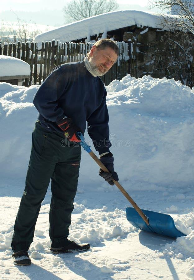 Snow digging stock image