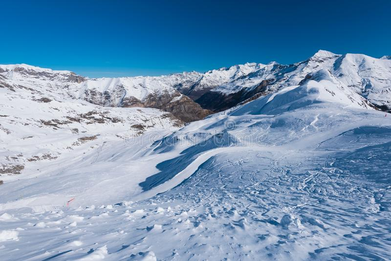 Snow downhill with traces stock photography