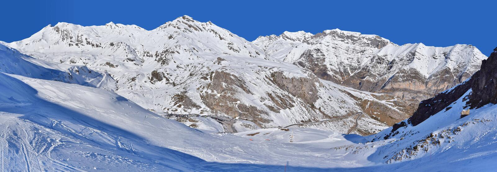 Snow downhill in the winter mountains stock images