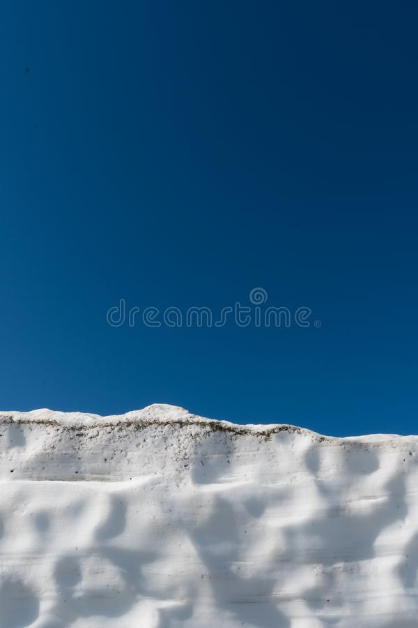 Snow Drift and Blue Sky. Vertical image with copy space royalty free stock image