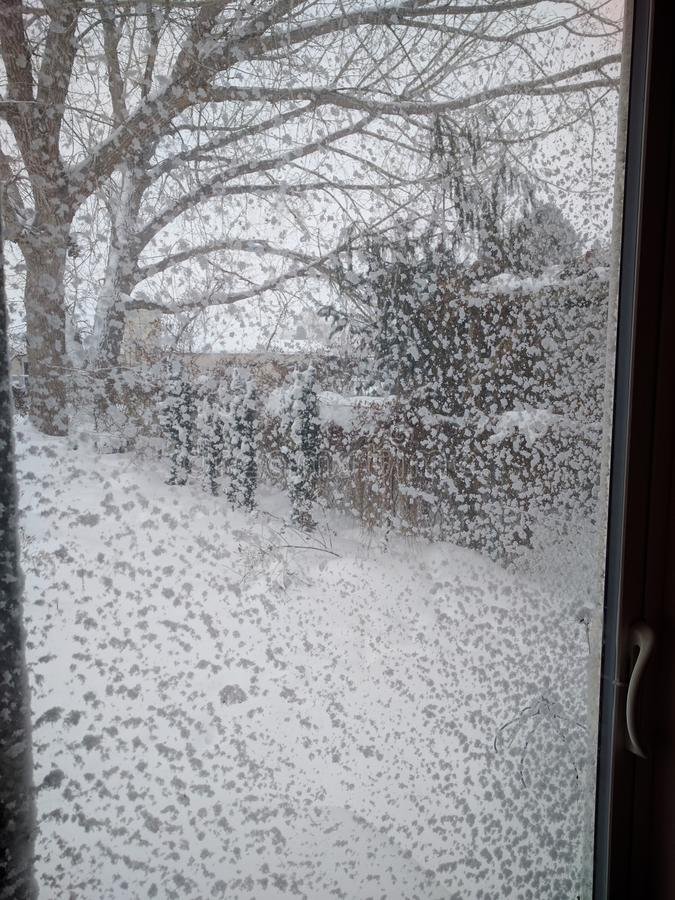 Snow Drift Window. Snow blown onto the window royalty free stock photos