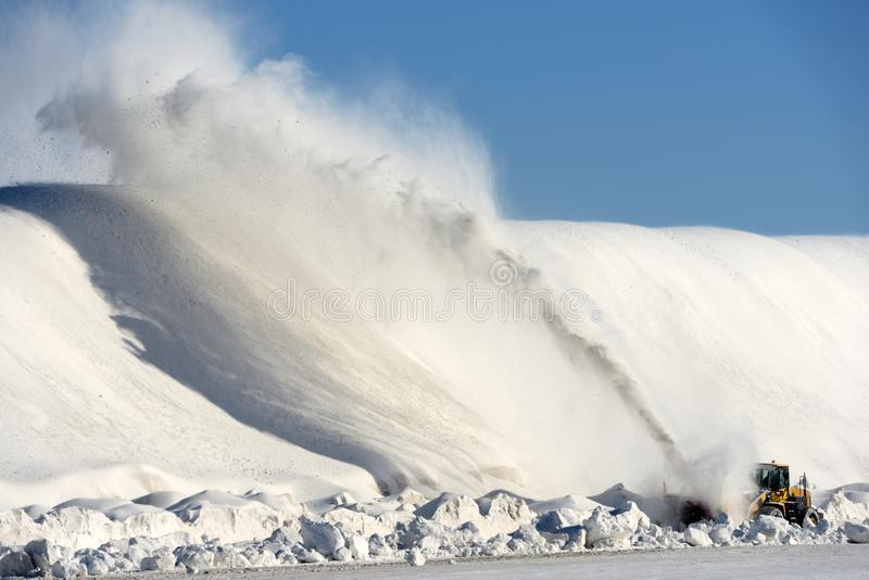 Snow dump. Industrial snow thrower at work at a local snow dump royalty free stock images