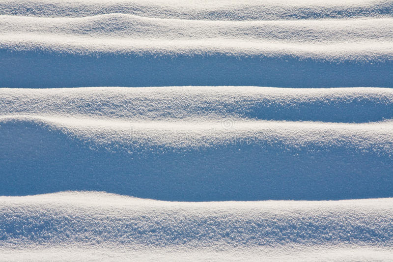 Snow dunes. In a field after a snowfall stock images