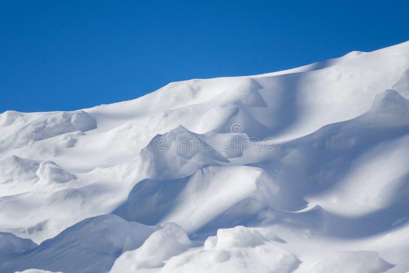 Snow dunes stock image