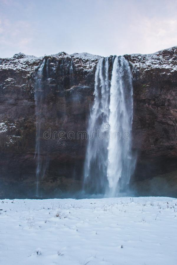 Snow Falling from Cliff Photo stock photo