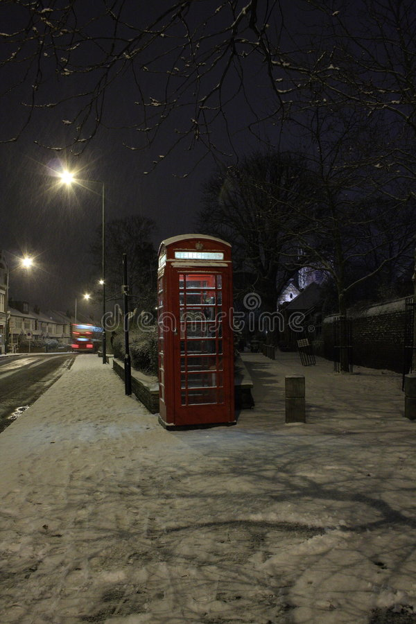 Snow falling in London stock images