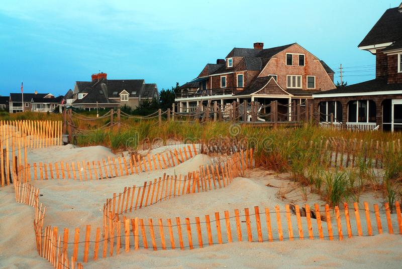 A snow fence protects the dunes stock photography