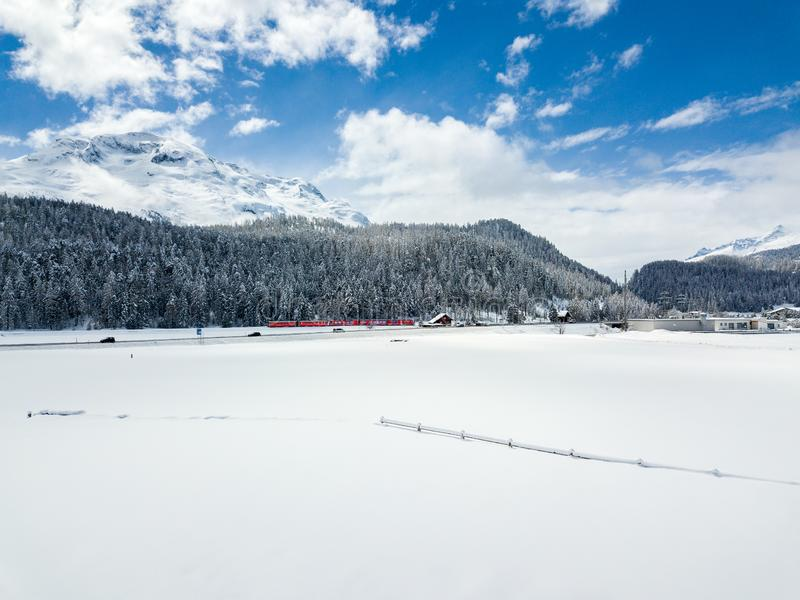 Snow field with forest and railway line stock photo