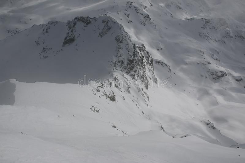 Snowy winter mountains of Switzerland. The snow filled winter mountains in Switzerland. Heavy winter with a snow storm moving into the mountains makes for great royalty free stock photos
