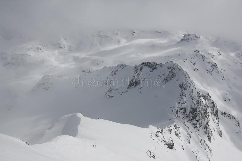 Snowy mountains of Switzerland. The snow filled winter mountains in Switzerland. Heavy winter with a snow storm moving into the mountains makes for great skiing royalty free stock photography