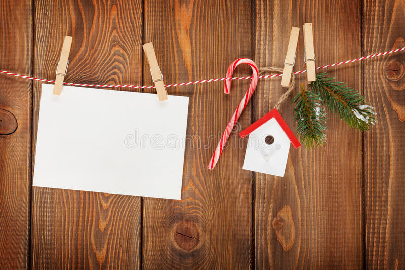 Snow fir tree, photo frame and christmas decor on rope stock images