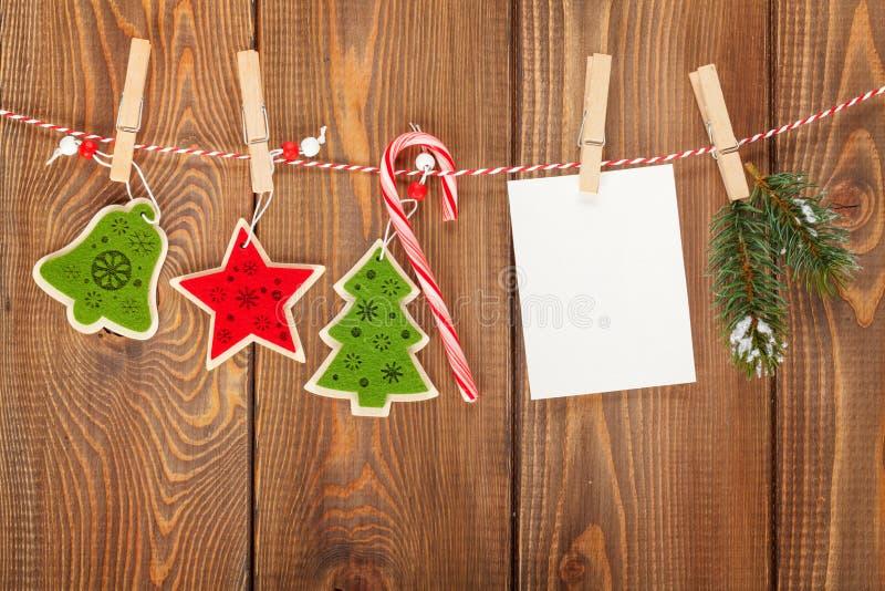 Snow fir tree, photo frame and christmas decor on rope stock photo