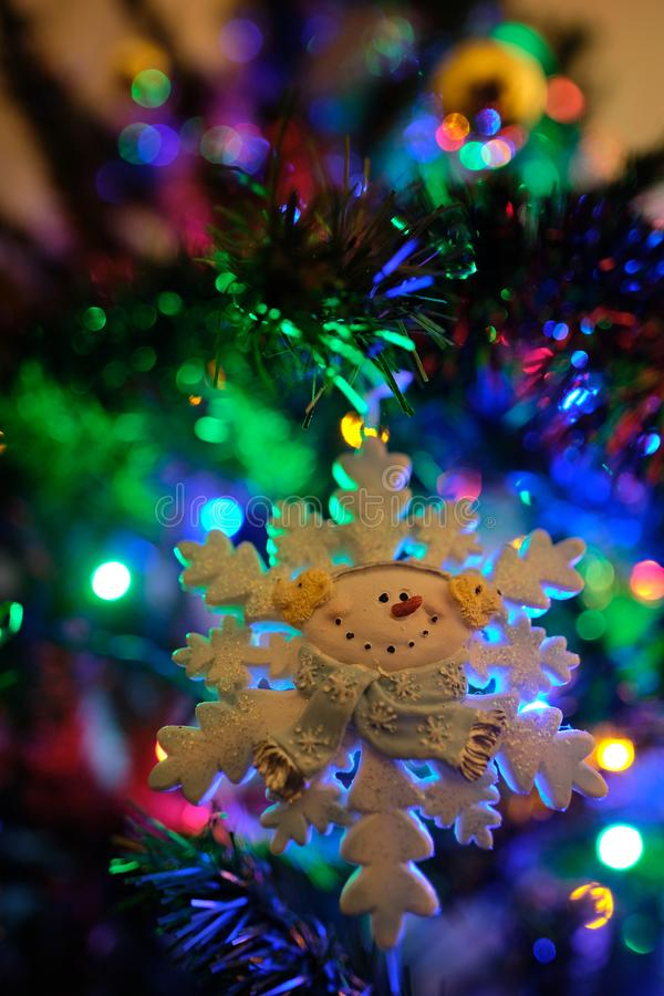 Snow flake ornament on a beautifully decorated Christmas tree stock photos