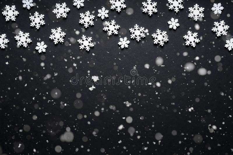 Snow flake texture and falling snow on black background.  stock image