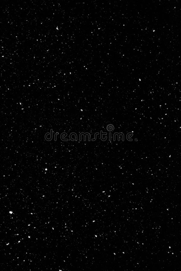 Snow flakes falling in night time. Natural texture. royalty free stock photos
