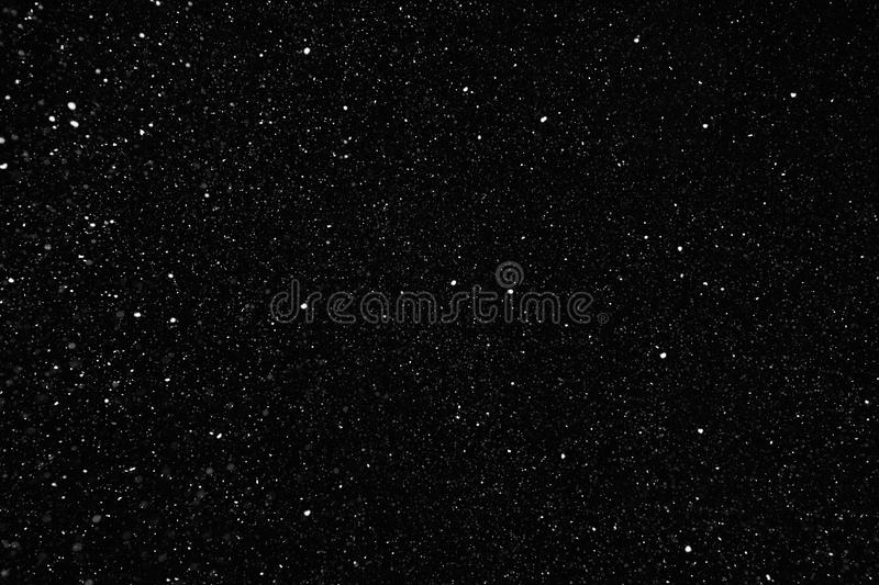 Snow flakes image on black stock photography