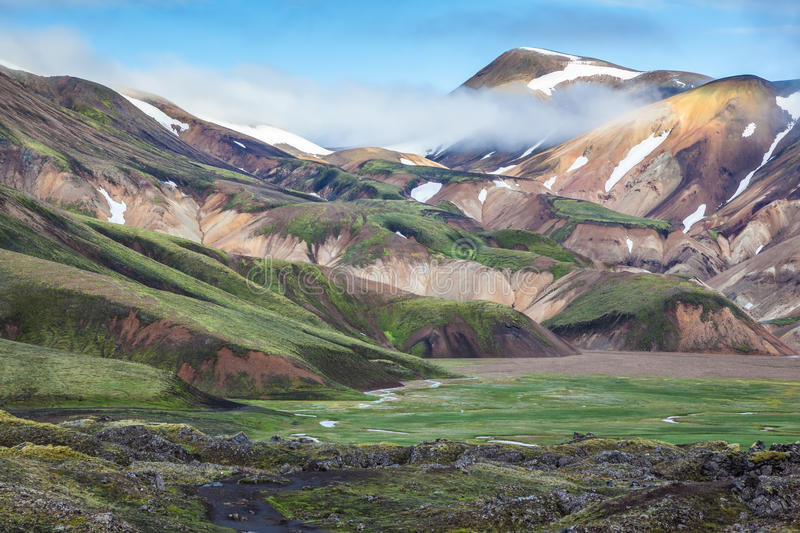 Snow and fog lies on rhyolite mountains stock images