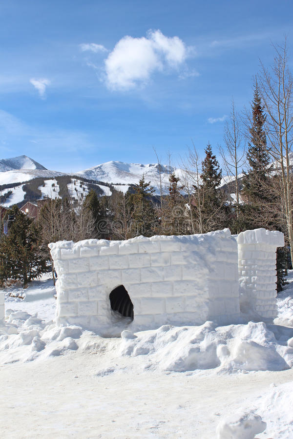 Snow Fort. A snow fort with a ski area in the background stock photography
