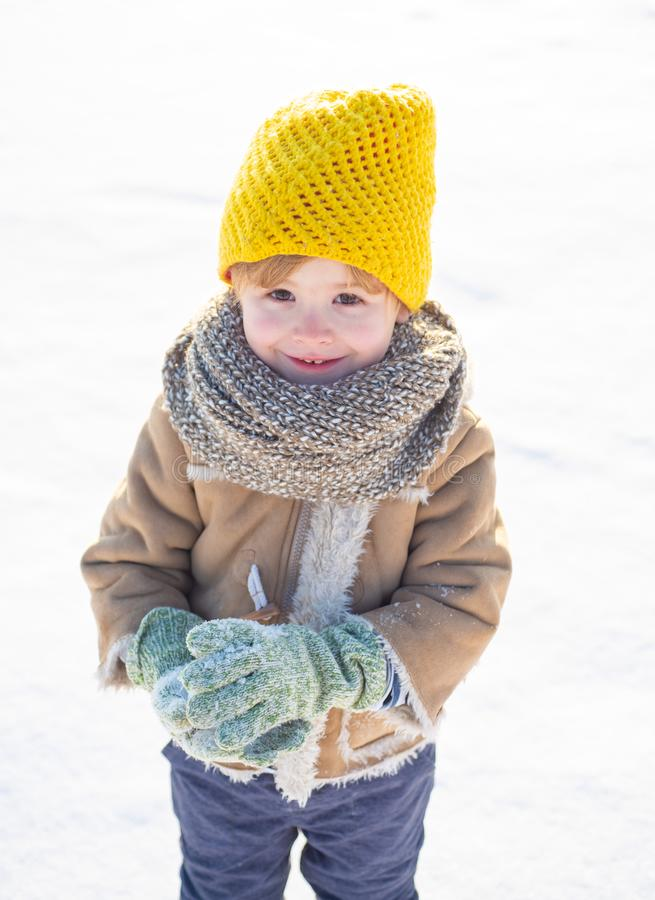 Snow games. Have wonderful holiday. Happy new year and merry christmas. Happy winter child snow background. Cute boy in. Winter clothes hat and scarf close up royalty free stock photos