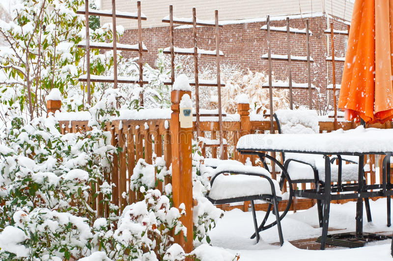 Snow on garden patio. Winter scenery royalty free stock photography