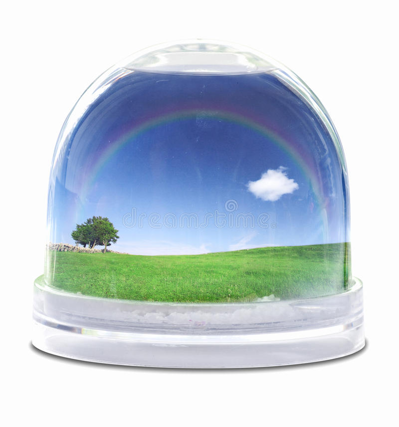 Snow globe. With green grass field, blue sky fully white cloud and lone tree royalty free stock image