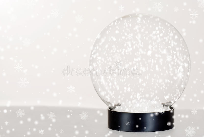 Snow globe. Closeup Snow globe with falling snow stock images