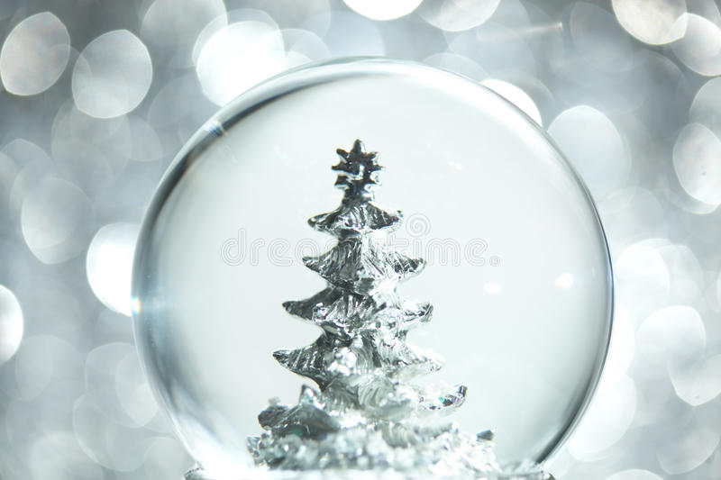 Snow globe with Christmas tree stock photo