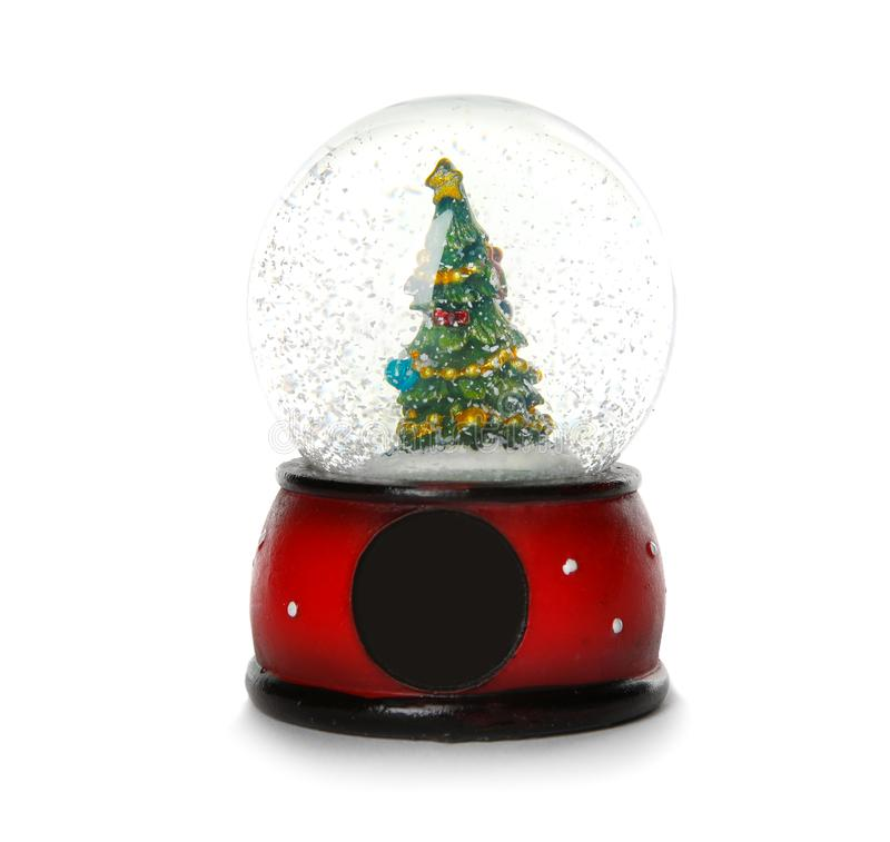 Snow globe with Christmas tree. Isolated on white stock photos