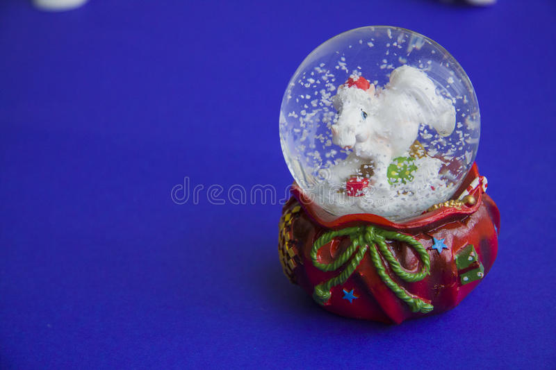 Snow globe with horse stock images