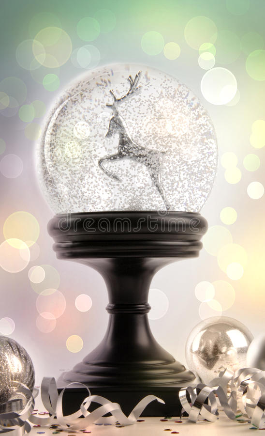 Snow globe with ornaments royalty free stock photo