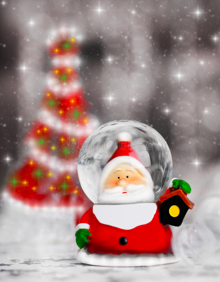 Snow globe Santa Claus, Christmas tree decoration royalty free stock image