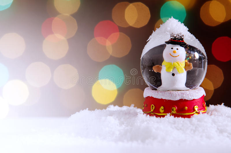 Snow Globe. With snowman over christmas lights background royalty free stock photos