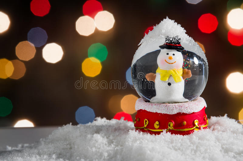Snow Globe. With snowman over christmas lights background royalty free stock images