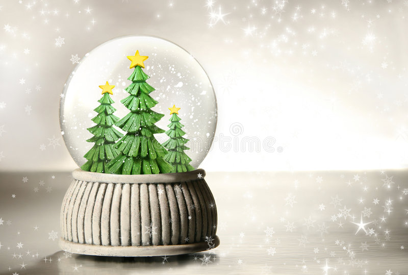 Snow globe with trees royalty free stock photography