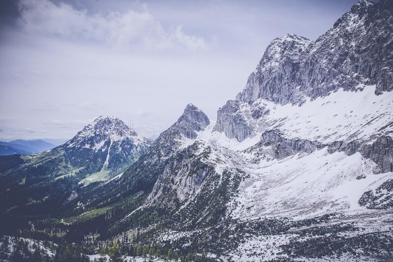 Snow on Gray Black Mountain Range royalty free stock image
