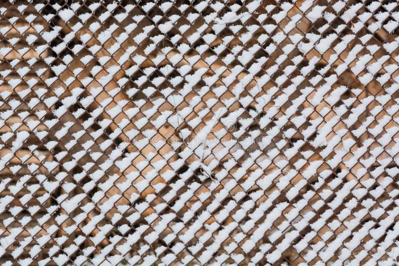 Snow on a grid. It is a lot of snow on a grid. stock image