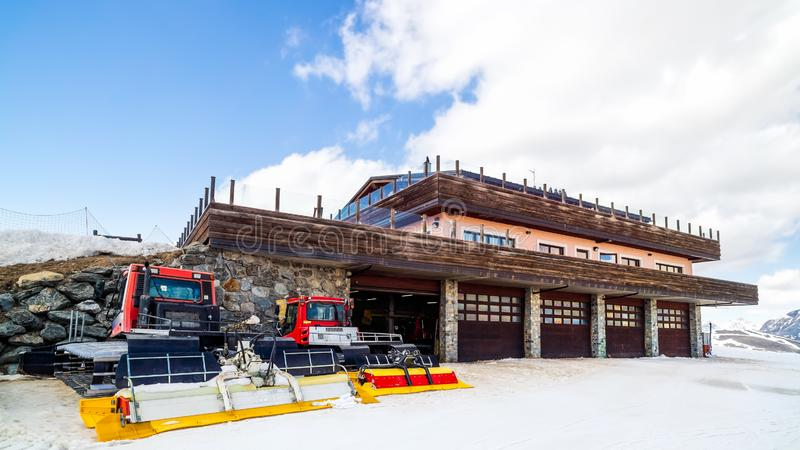 Snow groomers, mountain hut, Livigno, Italy, Alps. Snow groomers ready for action on slopes and pistes, mountain hut, Livigno, Italy, Alps royalty free stock photo