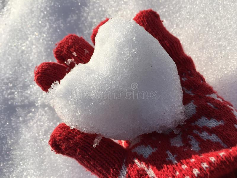 Snow heart. The days are getting colder , have a warm heart stock image